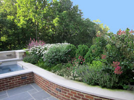 Long blooming, mostly midseason perennials add vibrancy to a spa, brick seating/retaining wall and bluestone pavilion overlooking the Ohio River.  Where open views from the home were important, slower, lower growing plants were chosen.