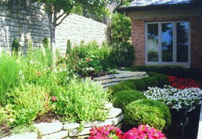 Shady side garden opens to a sunny view of Ohio River.