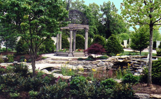 Two level water garden with crossing bridge to summer house (Manor House, Mason Oh).